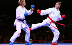BREMEN, GERMANY - NOVEMBER 08:  Gitte Brunstad(L) of Norway fights against Alizee Agier of France during their women's gold medal bout in the under 68 kg category at the Karate world championships at OVB-Arena on November 8, 2014 in Bremen, Germany.  (Photo by Martin Rose/Bongarts/Getty Images)